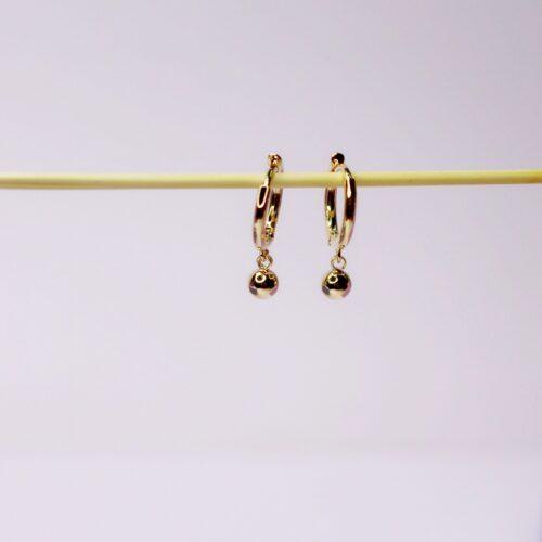 Pendientes aro con detalle bola dorada